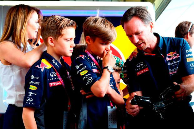 Infiniti Red Bull Racing Team Principal Christian Horner shows Romeo Beckham and Finn Isted a Formula One steering wheel in the team garage next to Geri Horner during the Formula One Grand Prix of Great Britain at Silverstone Circuit on July 5, 2015 in Northampton, England. (Photo by Mark Thompson/Getty Images)