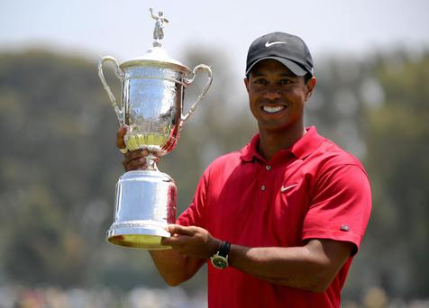 Tiger Woods with US Open trophy in 2008