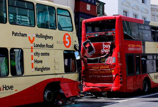 The buses involved in a crash in Brighton, East Sussex, which has left two people with life-threatening injuries and three others seriously hurt Credit: Gareth Fuller/PA Wire