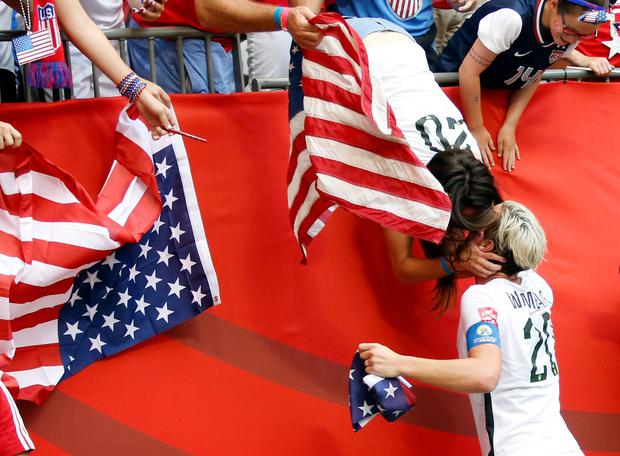 United States forward Abby Wambach (20) celebrates with her wife Sarah Huffman after defeating Japan in the final of the FIFA 2015 Women's World Cup at BC Place Stadium.