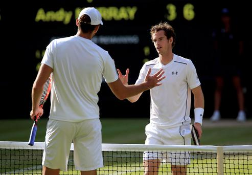 Andy Murray (right) and Ivo Karlovic shake hands after their match during day Seven of the Wimbledon Championships at the All England Lawn Tennis and Croquet Club
