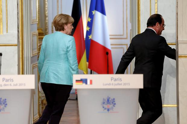 French President Francois Hollande and German Chancellor Angela Merkel leave after a joint statement at the Elysee Palace in Paris, France, July 6, 2015 following the Greek people's resounding 'No' to a European cash-for-reform deal in a referendum in Greece. REUTERS/Philippe Wojazer
