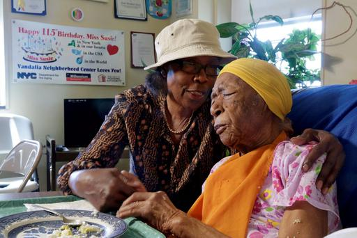 Susannah Mushatt Jones with her niece Lois Judge at her 115 birthday Credit: Richard Drew
