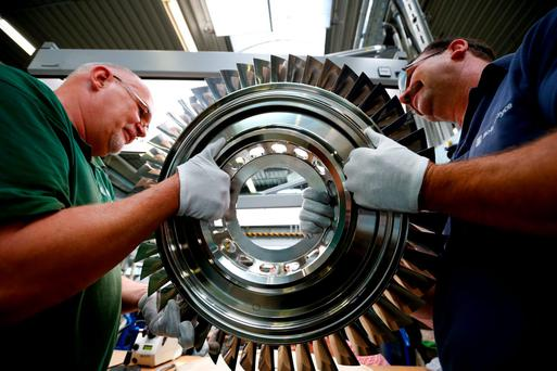 Rolls-Royce workers carry parts for one of its Trent XWB jet engines. The company's stock endured its biggest fall in over eight months yesterday.