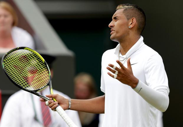 Nick Kyrgios of Australia reacts during his match against Richard Gasquet of France at the Wimbledon Tennis Championships in London, July 6, 2015. REUTERS/Henry Browne