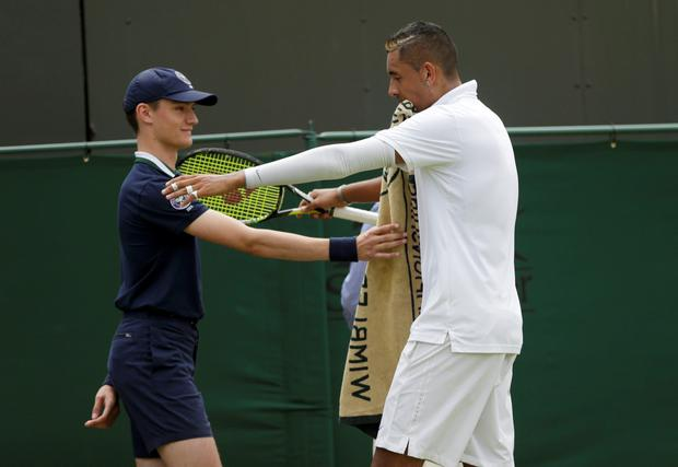 Nick Kyrgios of Australia hugs a ball boy during his match against Richard Gasquet of France at the Wimbledon Tennis Championships in London, July 6, 2015. REUTERS/Henry Browne
