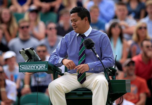 Umpire James Keothavong reacts after checking hawkeye from a challenge by Nick Kyrgios during day Seven of the Wimbledon Championships at the All England Lawn Tennis and Croquet Club, Wimbledon. Jonathan Brady/PA Wire