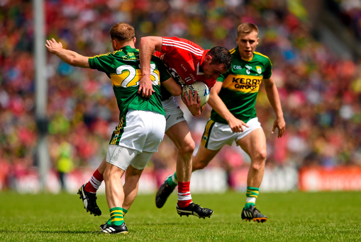 Cork's Donncha O'Connor attempts to get past Darran O'Sullivan, Kerry (Stephen McCarthy / SPORTSFILE)