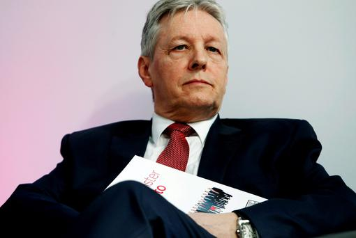 The North's First Minister Peter Robinson has called for David Cameron to act Credit: Brian Lawless/PA Wire)