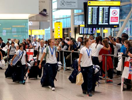 The England women's team arrive back at Heathrow Airport after the 2015 FIFA Womens World Cup in Canada. PRESS ASSOCAITION Photo. Picture date: Monday July 6, 2015. See PA story SOCCER England Women. Photo credit should read: Steve Parsons/PA Wire