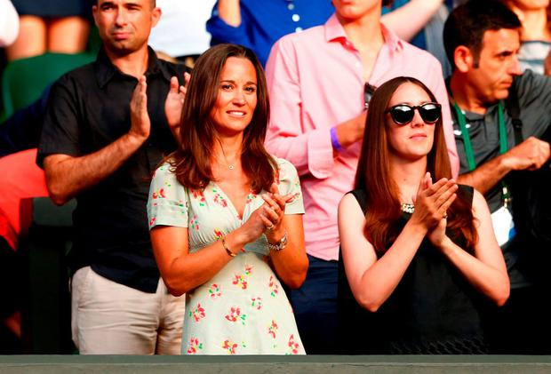 Pippa Middleton (C) watches the Gentlemen's Singles Fourth Round match between Roberto Bautista Agut of Spain and Roger Federer of Switzerland during day seven of the Wimbledon Lawn Tennis Championships at the All England Lawn Tennis and Croquet Club on July 6, 2015 in London, England. (Photo by Julian Finney/Getty Images)