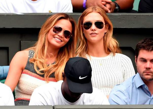 Chrissy Teigen and Karlie Kloss attend day seven of the Wimbledon Tennis Championships at Wimbledon on July 6, 2015 in London, England. (Photo by Karwai Tang/WireImage)