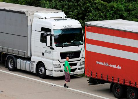 Lorries parked on the M20 in Ashford as Kent Police reintroduced Operation Stack after around 150 migrants tried to storm the Channel Tunnel terminal in Calais in a bid to board UK-bound freight Credit: Gareth Fuller/PA Wire