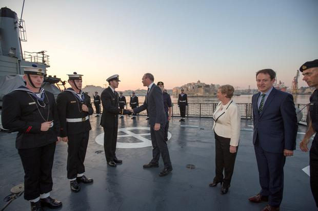 Minister Simon Coveney meeting Ensign Ben Crumplin on the flight deck of the LE Eithne after docking in Valetta, Malta with Mnisters Frances Fitzgerald and Sean Sherlock. Also inlcluded on right is commander Pearse O'Donnell