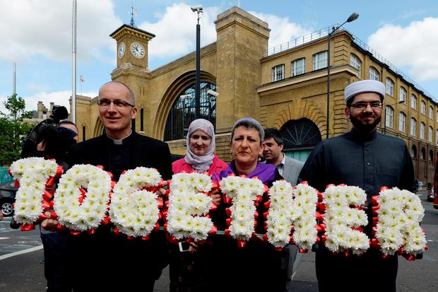 (From the right) Imam Qari Asim, Imam of Makkah Masjid, Leeds?? largest mosque; Rabbi Laura Janner-Klausner, Senior Rabbi, Movement for Reform Judaism; Julie Siddiqi of the Islamic Society of Britain, Revd Bertrand Olivier, Vicar of All-Hallows-by-the-Tower, London, carry a floral tribute to Tavistock Square, London, as faith leaders retraced where the devastating 7/7 London bombings took nearly 10years ago. Stefan Rousseau/PA Wire
