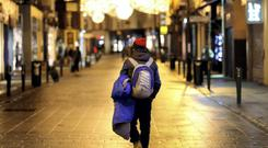 A homeless man makes his way up Dublin's Grafton Street in the early hours, looking for a place to bed down for the night. 5/12/14 Pic Frank Mc Grath