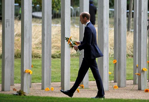 Britain's Prince William pays his respects at the memorial to victims of the July 7, 2005 London bombings, in Hyde Park, central London, Britain July 7, 2015. Britain fell silent on Tuesday to commemorate the 10th anniversary of attacks targeting London public transport which killed 56 people, the first suicide bombings by Islamist militants in western Europe. REUTERS/Peter Nicholls