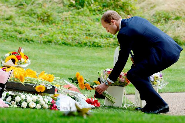 The Duke of Cambridge lays a wreath at the July 7 memorial in Hyde Park, London, in memory of those who died in the 7/7 bombings, as Britain remembers the July 7 attacks amid a welter of warnings about the enduring and changing threat from terrorism a decade on. Anthony Devlin/PA Wire