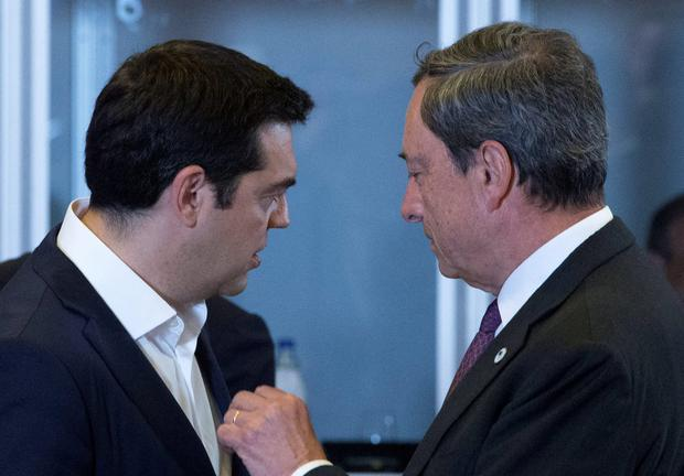 Greek Prime Minister Alexis Tsipras (L) talks with European Central Bank President Mario Draghi during a euro zone EU leaders emergency summit on the situation in Greece in Brussels, Belgium, July 7, 2015. Greece faces a last chance to stay in the euro zone on Tuesday when Tsipras puts proposals to an emergency euro zone summit after Greek voters resoundingly rejected the austerity terms of a defunct bailout. REUTERS/Yves Herman