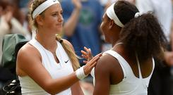 Serena Williams of the U.S.A. shakes hands with Victoria Azarenka of Belarus