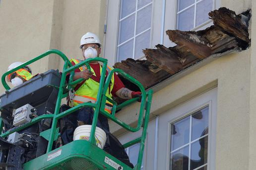 Inspectors have blamed severe dry rot for the balcony collapse in which five Irish students and one American student died
