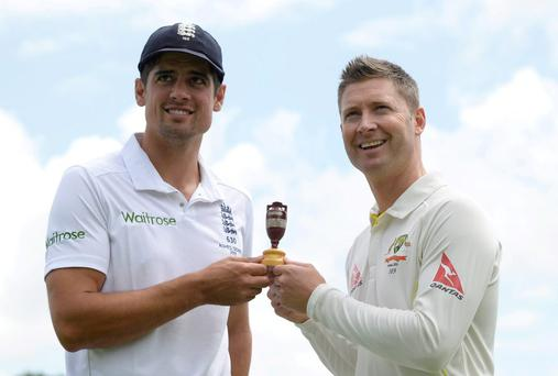England captain Alastair Cook and Australian counterpart Michael Clarke pose with a replica of the Ashes urn in Cardiff