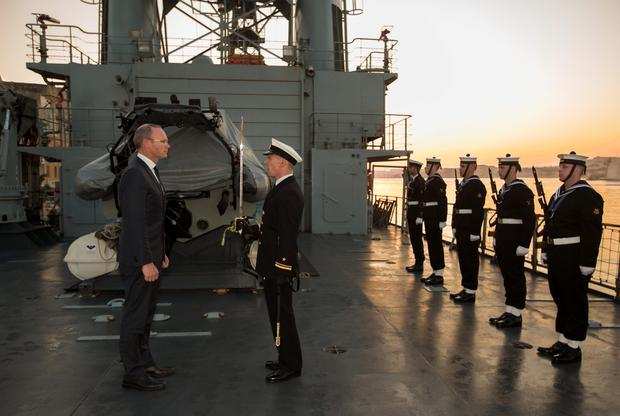 Defence Minister Simon Coveney gets a guard of honour on the flight deck of the LÉ Eithne after it docked in Valetta, Malta