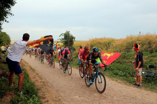 Nicolas Roche rides on the cobbles on stage 4 of the Tour de France from Seraing to Cambrai