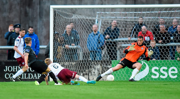 Dundalk's John Mountney shoots to score his side's fourth goal