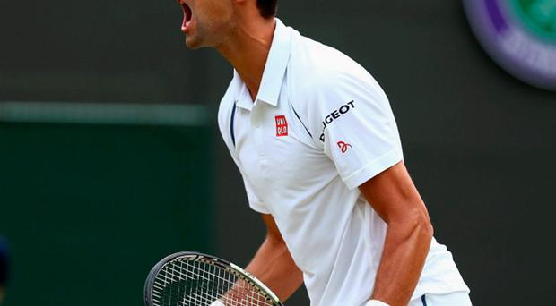 Novak Djokovic celebrates after clinching his place in the quarter-finals