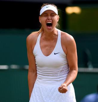 Maria Sharapova celebrates against Coco Vandeweghe on day Eight of the Wimbledon Championship