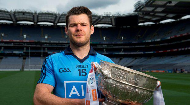 6 July 2015; Kevin McManamon, Dublin, with the Delaney cup, at the GAA Leinster Football Final Preview. Croke Park, Dublin. Picture credit: D?ire Brennan / SPORTSFILE