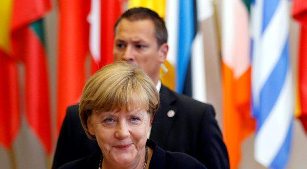 Germany's Chancellor Angela Merkel leaves an emergency euro zone summit in Brussels