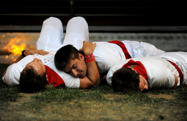 Revellers sleep at the San Fermin festival in Pamplona, northern Spain, July 8, 2015. REUTERS/Eloy Alonso