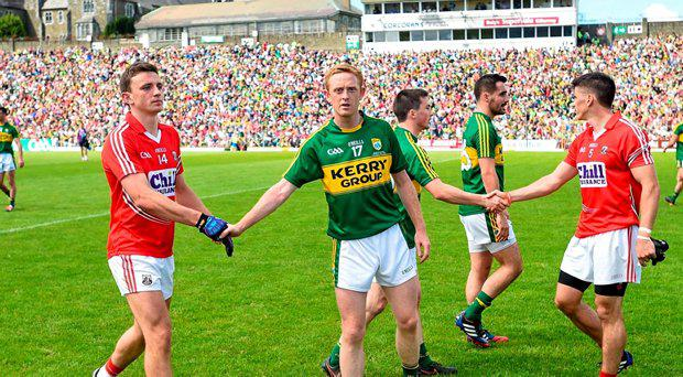 5 July 2015; Colm Cooper, Kerry, shakes hands with Mark Collins, Cork, after the game ended in a draw. GAA Football Senior Championship Final, Kerry v Cork. Fitzgerald Stadium, Killarney, Co. Kerry