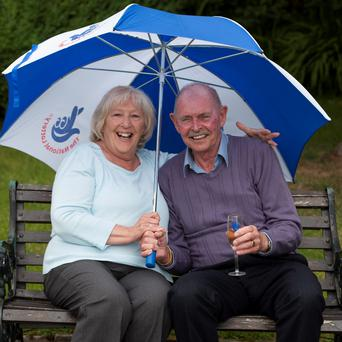 Camelot handout photo of Terry and Ann Bradbury, from Buxton as they celebrate their win