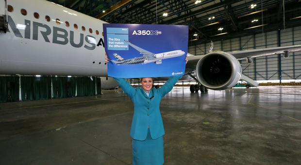 AerLingus cabin crew Claire Teehan with the new Airbus A350-900 XWB MSN005 pictured this morning at Hangar 6 in Dublin Airport. Picture: Colin Keegan, Collins Dublin.