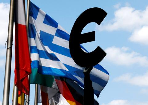 A Greek flag flies behind a statue depicting European unity outside the European Parliament in Brussels this week – the hard political reality is that when it comes to Greece against the rest, the rest is always going to win