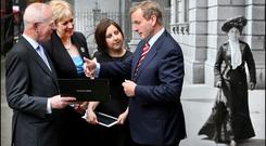 Paul Shovlin of the National Library; Arts Minister Heather Humphreys; Ciara Kerrigan, who oversaw the digitisation of parish registers at the National Library and Taoiseach Enda Kenny at the launch of the new web-repository of parish records. Photo: Steve Humphreys