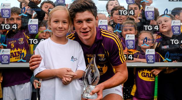 Felicja Davis, aged 7, Enniscorthy, presents Wexford's Conor McDonald with the man of the match award