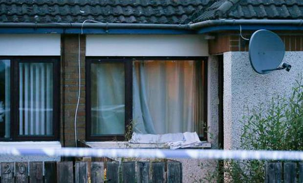 A smashed window at the scene of the attack Pic: Belfast Telegraph