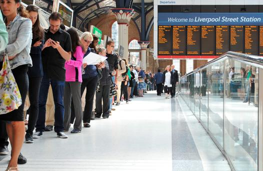 People queuing for the Number 11 bus at Liverpool Station in central London as commuters face travel misery trying to get to work because of a strike which has brought London Underground to a standstill.