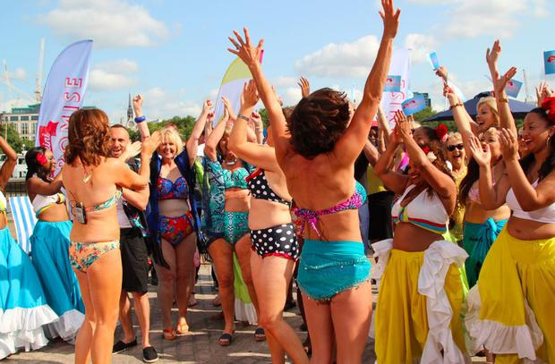 Lorraine Kelly (to the left, in a floral bikini) with her guests during the live dancing segment for the 'Bikini Promise' campaign Pic: ITV