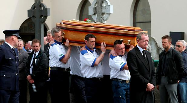 Members of the MCI Medical team carry the coffin of motorbike racing doctor John Hinds from St Patrick's Church in Portaferry, Co. Down, following his requiem Mass. Photo: PA