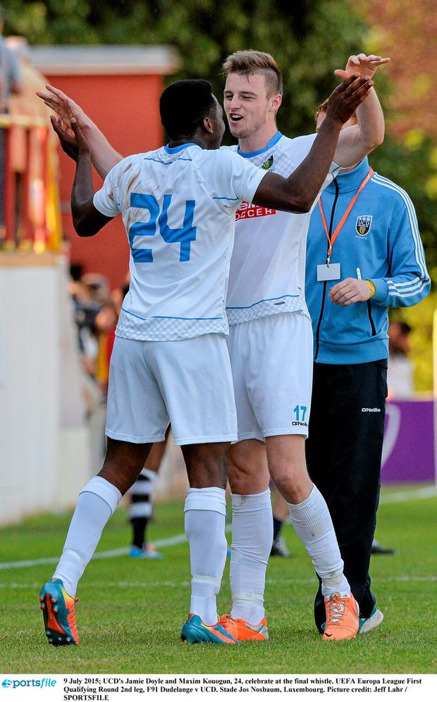 UCD's Jamie Doyle and Maxim Kouogun, 24, celebrate at the final whistle