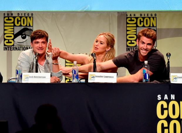 (L-R) Actors Josh Hutcherson, Jennifer Lawrence and Liam Hemsworth speak onstage at the audience at the
