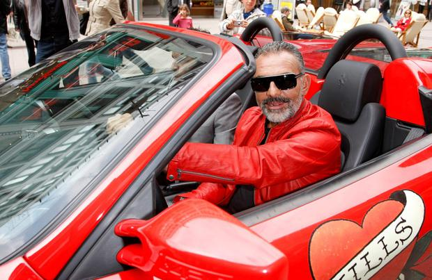 Designer Christian Audigier arrives in a Ferrari in front of the Douglas store for his autograph signing during his Hamburg visit on May 27, 2010 in Hamburg, Germany. (Photo by Florian Seefried/Getty Images)