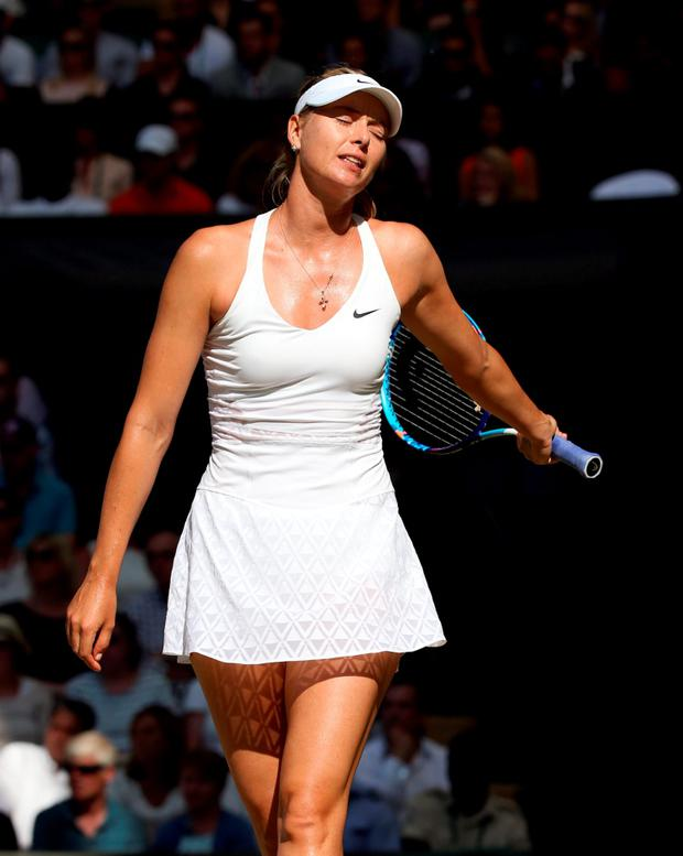 Maria Sharapova reacts during her match against Serena Williams