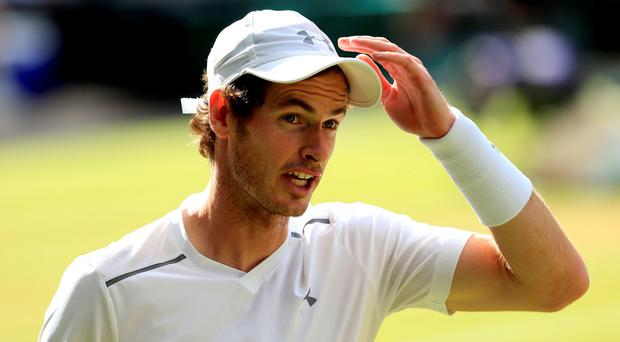 Andy Murray in action against Roger Federer during day Eleven of the Wimbledon Championships