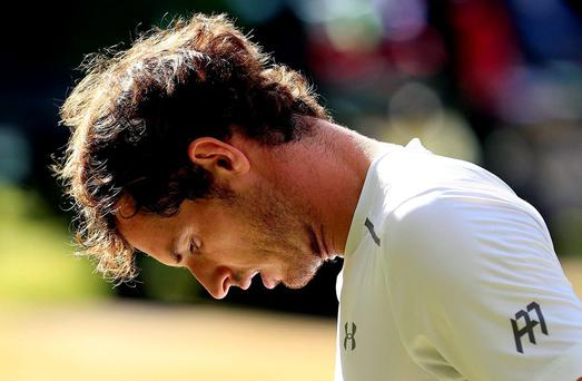 Roger Federer looks dejected during his match against Roger Federer day Eleven of the Wimbledon Championships
